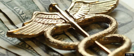 Expensive health care concept caduceus on US money